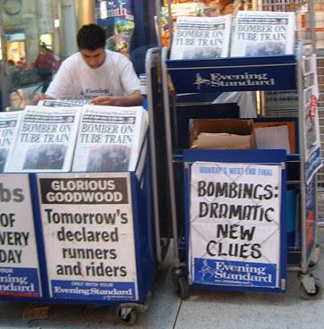 Evening Standard vendor at with bombing headline
