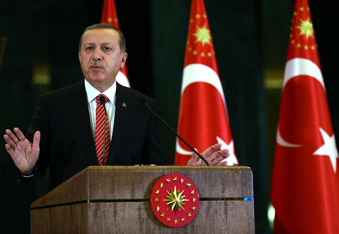 Turkish President Recep Tayyip Erdogan speaks during a meeting at the presidential palace in Ankara, Turkey, Tuesday, Nov. 24, 2015. In a long-feared escalation of tensions between Russia and NATO as well as the Syrian conflict, Turkey on Tuesday shot down a Russian warplane that it claims had crossed into its airspace during a sortie against rebels in Syria. Turkey has vowed to support the Syrian Turkmen and Erdogan on Tuesday criticized Russian actions in the Turkmen regions, saying there were no Islamic State group fighters in the area. (AP Photo/Kayhan Ozer, Presidential Press Service, Pool )