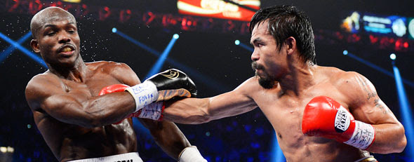 Manny Pacquiao lands a right to the head of Timothy Bradley during their WBO welterweight title fight at MGM Grand Garden Arena on Saturday in Las Vegas. (Photo by Kevork Djansezian/Getty Images)