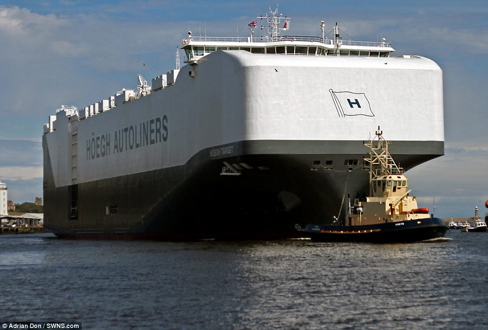 Hoegh Target, the world's biggest Pure Car and Truck Carrier (PCTC) which can carry 8,500 vehicles, dwarfs North Shields Fish Quay as it is towed into Tyne and Wear this week. The vessel, officially launched in June, has arrived into Britain on its maiden voyage from China