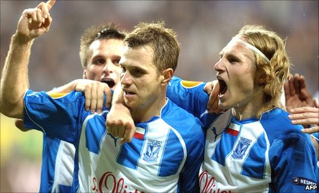 Lech Poznan celebrate Dimitrije Injac's opening goal against Manchester City
