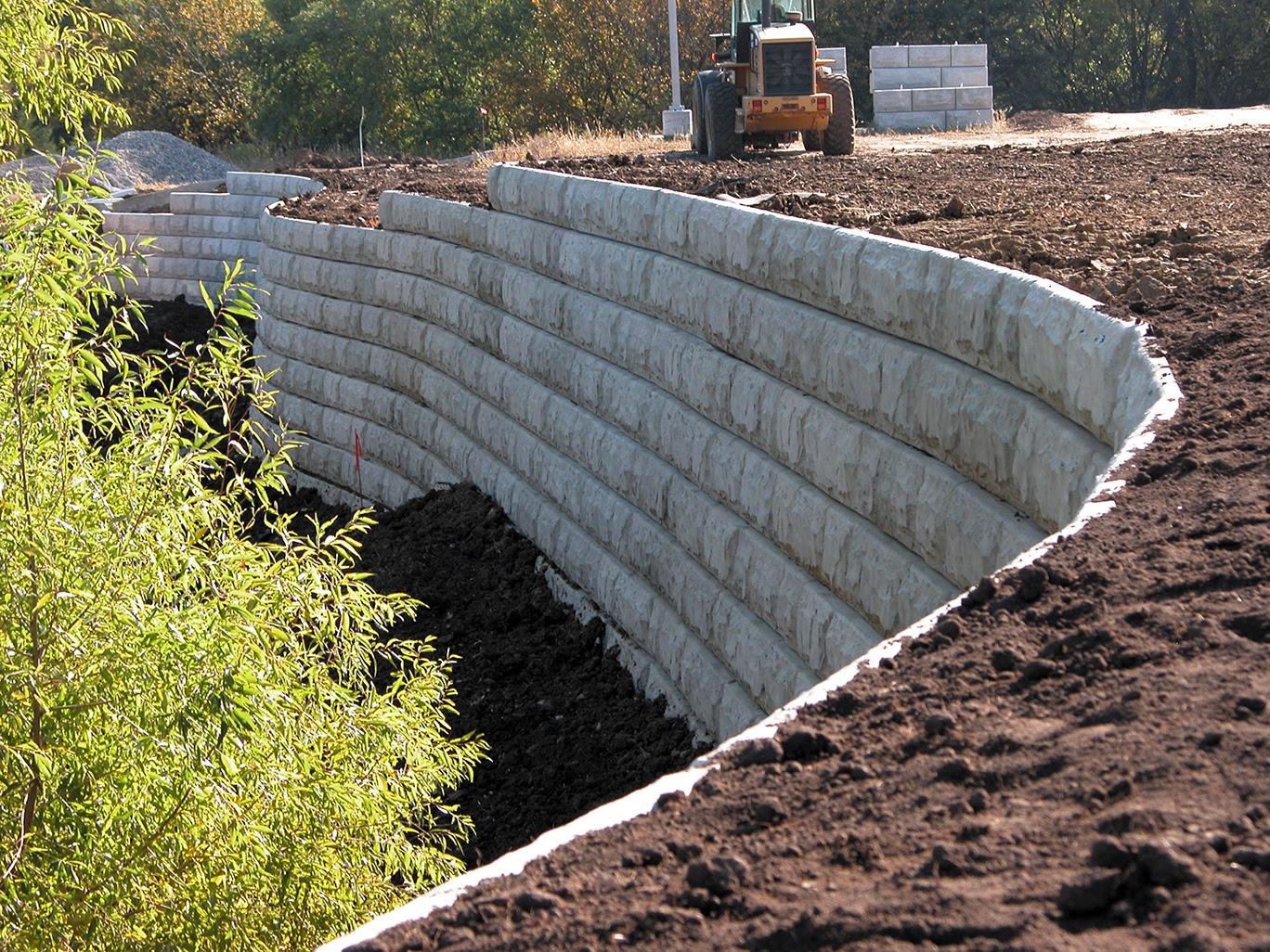 Precast concrete gravity wall retaining wall install 5