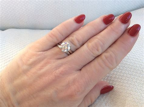 Four claw solitaire engagement ring with a plain wedding