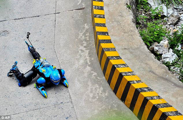 Fast: Mr Blondeau's suit has 31 rollerblade-like wheels on the torso, back, and most of the major joints, allowing him to ride in a number of positions at speeds of up to 70mph downhill