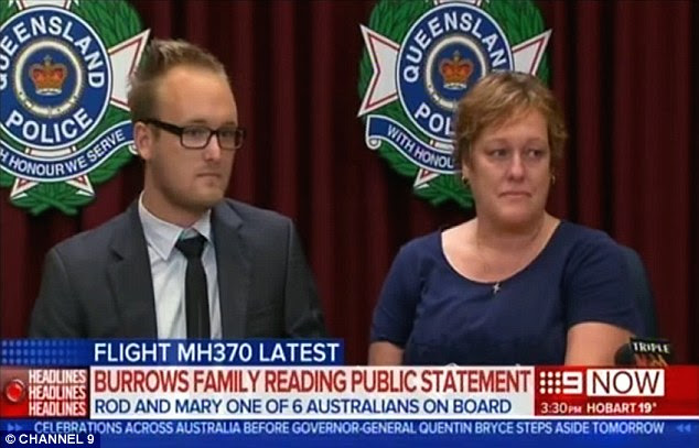 Devastated: Jayden Burrows, supported by his aunt Kaylene Mann, pictured during a press conference on Tuesday, are among Australian relatives of those who died on MH370