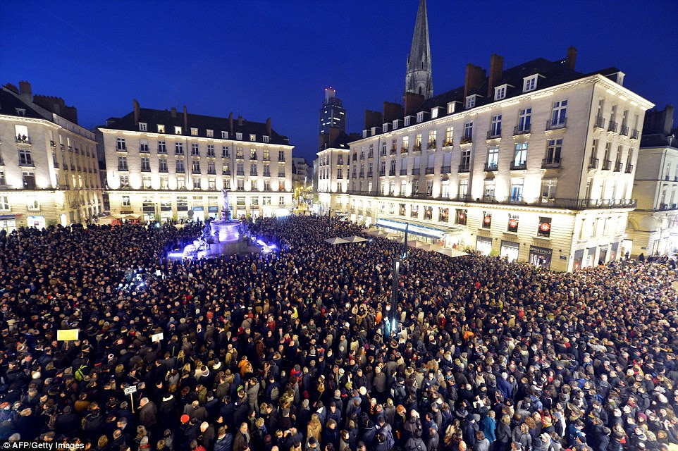 Elsewhere: People gather at the Place Royale in Nantes to show their solidarity for the victims of the attack  on the offices of the satirical weekly