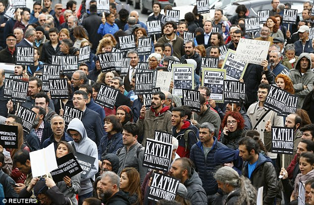 Uprising: Demonstrators hold placards which reads 'We know the murderer!' during a protest against a bombing in Ankara on October 13, 2015. A blast today is believed to have been targeted at a military convoy