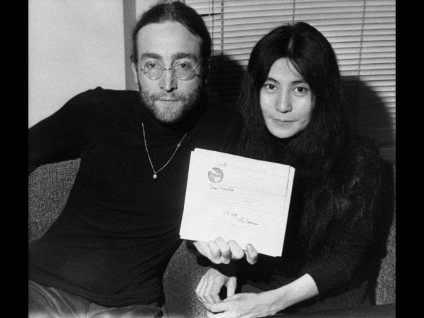 John Lennon and his wife Yoko Ono display a letter from Lennon to British Prime Minister Harold Wilson at the Beatles' Apple Records headquarters, Nov. 25, 1969. The letter explains his reasons for returning his Order of the British Empire medal, including British support for the U.S.A.'s war in Vietnam and British involvement in Biafra and Nigeria.