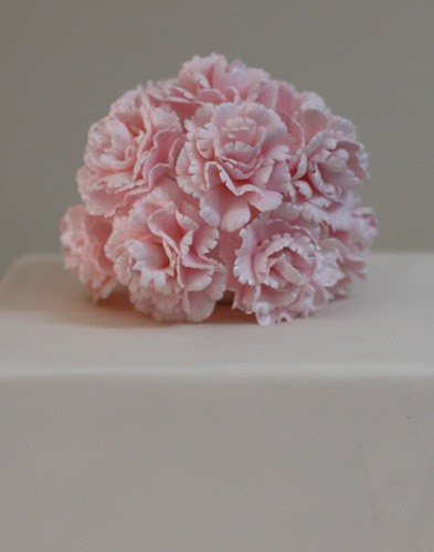 Pom pom of pink carnations by Louisa Morris Cakes