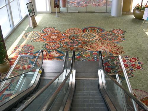 Kaleidescopes wrapped around the escalator