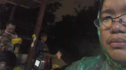 preparing for a scene under a heavy rain