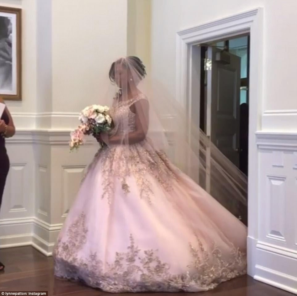 Omarosa's friend Lynne Patton captioned this photo of her outfitted in a pink wedding gown: 'A stunning bride on this beautiful, blissful DC morning'