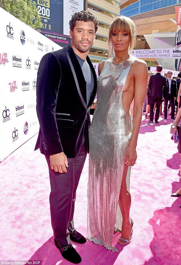 Date night: The beauty was joined by her fiance Russell Wilson on the pink hued carpet
