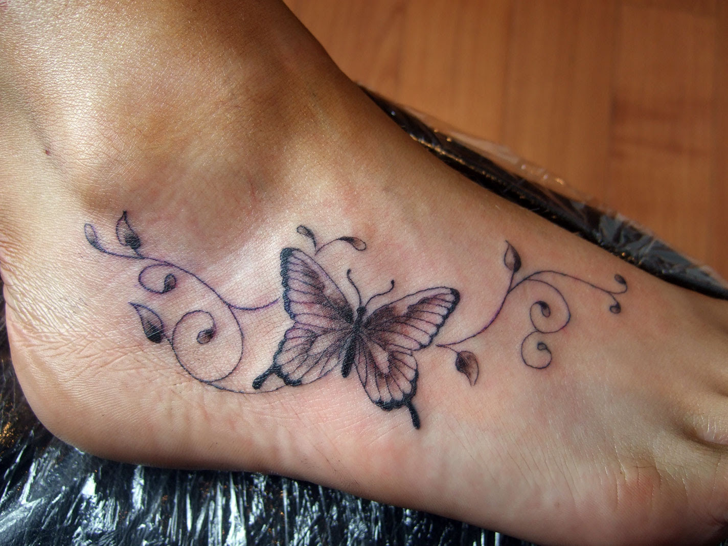 Awesome Grey Ink Butterfly Tattoo On Right Foot