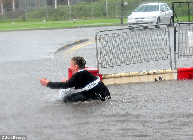 The whole of Britain was hit by a heavy downpour. Here there is flooding in DUNBAR, East Lothian