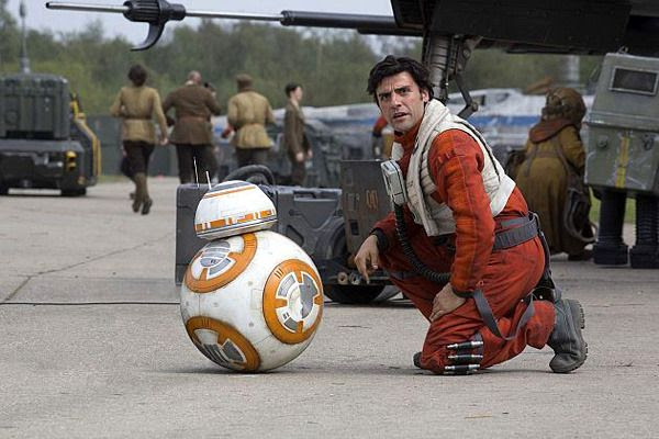 At a Resistance base, Poe Dameron (Oscar Isaac) talks to BB-8 in STAR WARS: THE FORCE AWAKENS.
