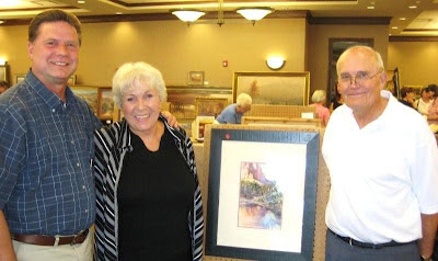 Ev and Jim Goodman with new Roland Lee painting