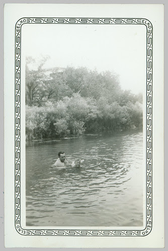 Man and a child at the swimming hole.