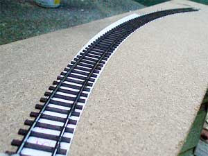curved track in painting jig