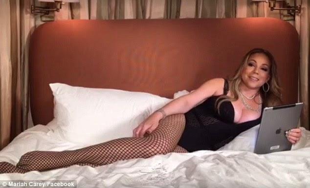 Indo viral!  Mariah Carey transmitiu um vídeo ao vivo em lingerie para sua página oficial no Facebook do que ela disse que era um quarto de hotel em Los Angeles na quinta-feira;  Ele foi viral quase imediatamente