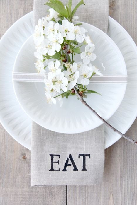 A beautiful place setting that could be adapted for fall with a sprig of leaves | Friday Favorites at www.andersonandgrant.com