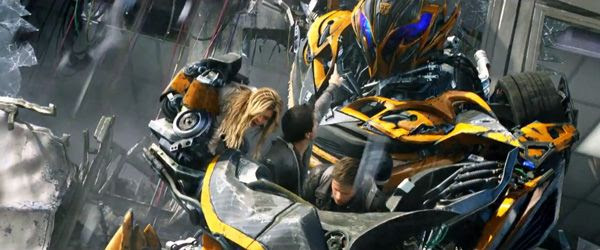 Bumblebee comes to the rescue of Cade Yeager, Tessa and Shane (Jack Reynor) in TRANSFORMERS: AGE OF EXTINCTION.