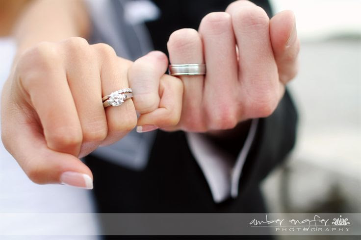 Pinky swear showing off the wedding rings.... this is necessary!