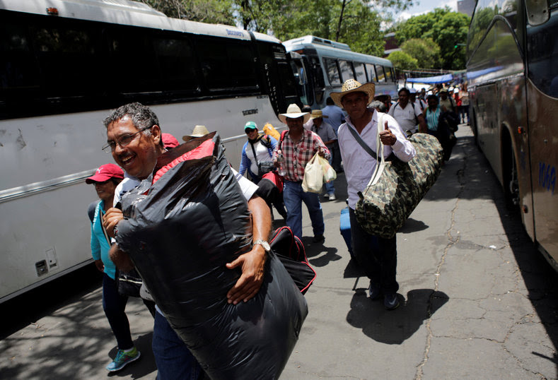 Protesters from the National Coordinator of Education Workers (CNTE) teachers' union arrive in Mexico City to attend a march against President Enrique Peña Nieto