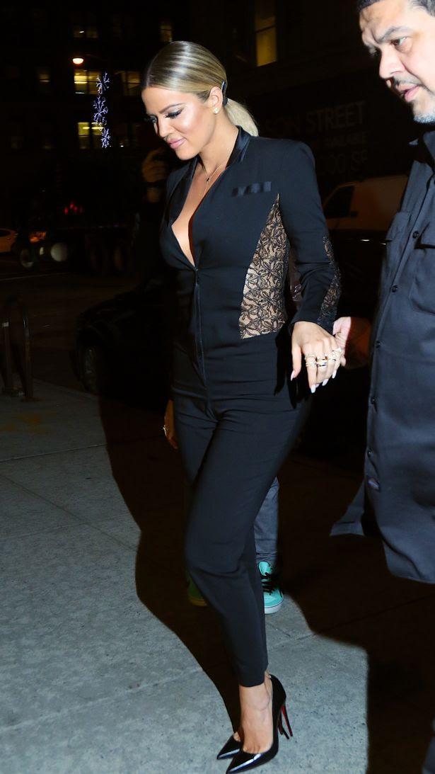 Khloe Kardashian looks stunning in a black lace jumpsuit