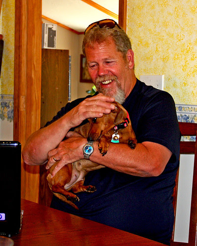 Uncle Mike holding Peaches and laughing after sticking his tongue out at me.  :-))