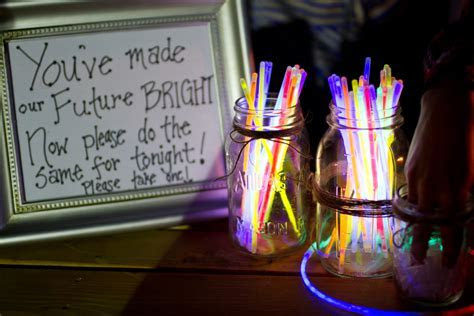 glow sticks welcome table wedding reception ideas   OneWed.com