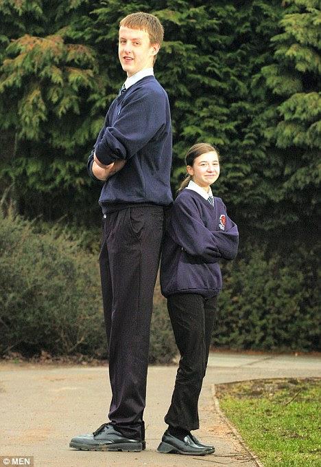 Towering: Bradley Fisher dwarfs 4ft 6in tall schoolmate Zoe McDermott