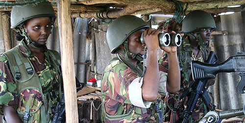 Operation Linda Nchi:Caroline Lang'at (right), 23, from Nakuru Phyllis Semo (left), 23, and another soldier doing surveillance in the fight against the Al-Shabaab group in Somalia on November 11, 2011. by Pan-African News Wire File Photos