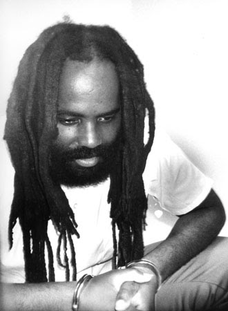 Despite a 2001 federal court decision overturning his death sentence, Mumia Abu-Jamal has never left his death row cell. – Photo: Prison Radio