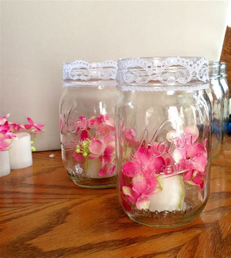 Wedding  Silk flowers hot glued to flame less candles