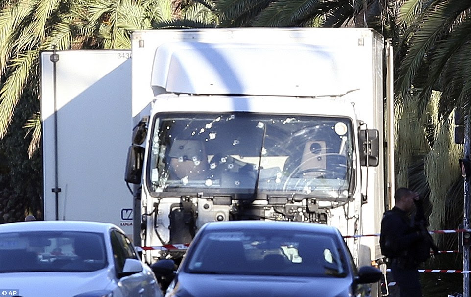 Terror attack: At least 84 people were killed and dozens more critically injured last night when a terrorist killer drove this truck, riddled with bullets, through crowds celebrating Bastille day in Nice