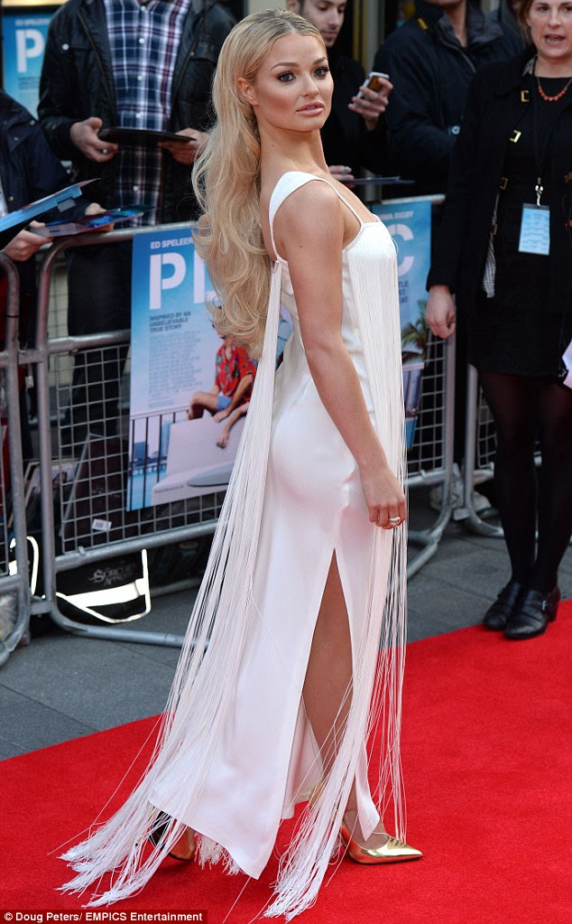 Fringed benefits: Emma's dress was very clingy, showing off her petite frame