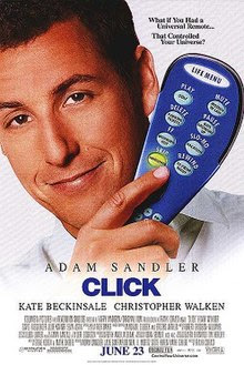 Adam Sandler holding a television remote control