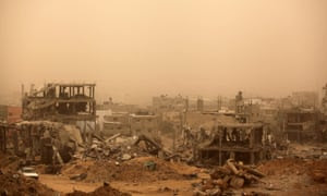 A sandstorm over ruined buildings in Gaza.