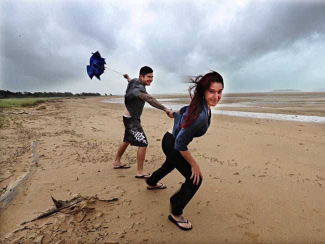 Daniel McDonald and Tammie Pattel battle the elements at Mackay beach. Picture: Annette Dew