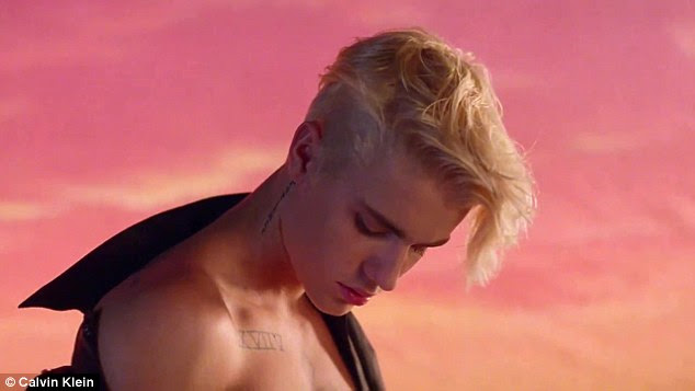 Any excuse: Bieber, 21, goes shirtless in the video clip which features numerous stars