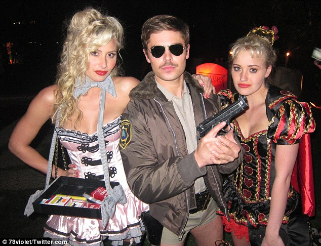 Those are tiny shorts! Zac Efron dressed as a Reno 911 police officer as he joined the Michalka sisters