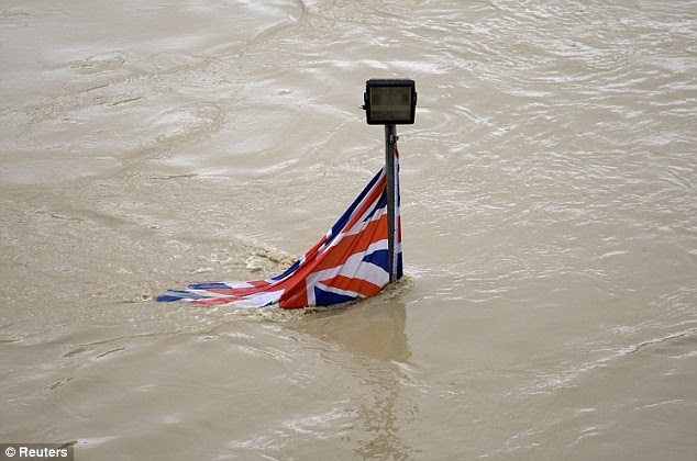 A British flag hanging from a lamp of a boat landing platform is submerged by the Tiber today
