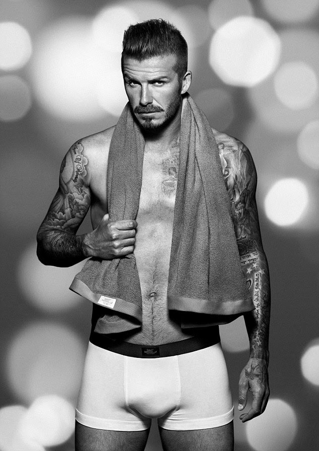 Happy holidays! David Beckham models the latest range from his underwear collection for H&M