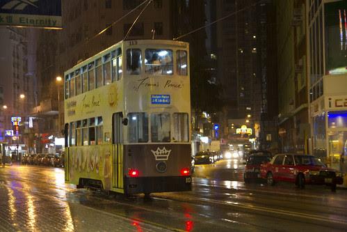 Bus at rain-drenched street of Hong Kong