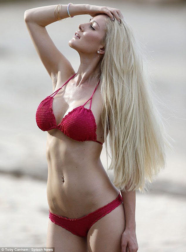 Downsized: The former reality star now has a C-cup after getting her F-cup implants removed