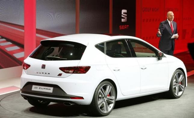 Seat's CEO Juergen Stackmann speaks next to a Seat Leon Cupra during a Volkswagen Group Night event ahead of the 84th Geneva Motor Show at the Palexpo Arena in Geneva late March 3, 2014. REUTERS/Arnd Wiegmann