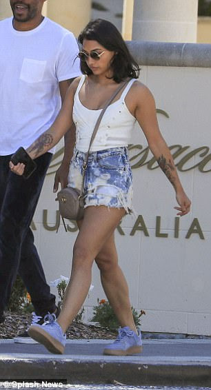 Legs for days: Meanwhile, Vanessa showed off her tanned and toned limbs in a pair of frayed acid-wash denim hotpants