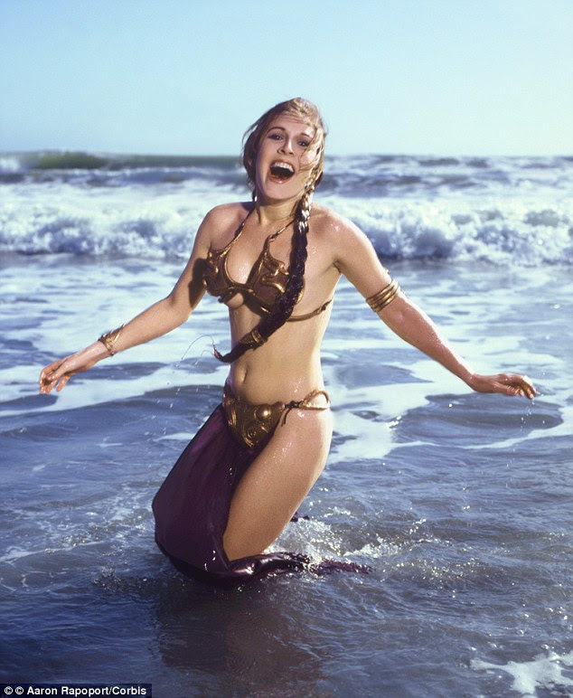 Pin-up: The vintage shots see a 27-year-old Fisher cavort in some raucous waves while showcasing her enviable figure in the same metal bikini she sported in Star Wars Episode VI: Return of the Jedi