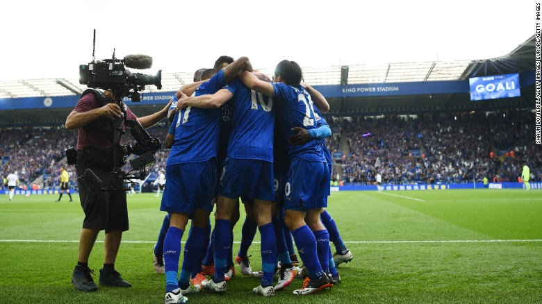 Leicester City players celebrate their team's first goal against Everton.